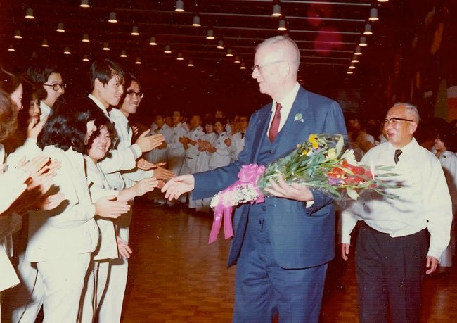 photo of Dr. Deming shaking hands with workers at Ricoh